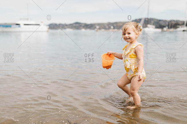 Toddlers playing on the beach and splashing