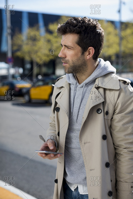 Businessman using technology  in the city, Barcelona, Spain.