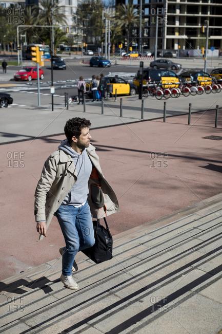 Businessman walking fast. Going to work. Barcelona, Spain.