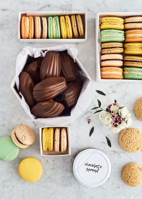 Box of macarons, choux, Madeleines