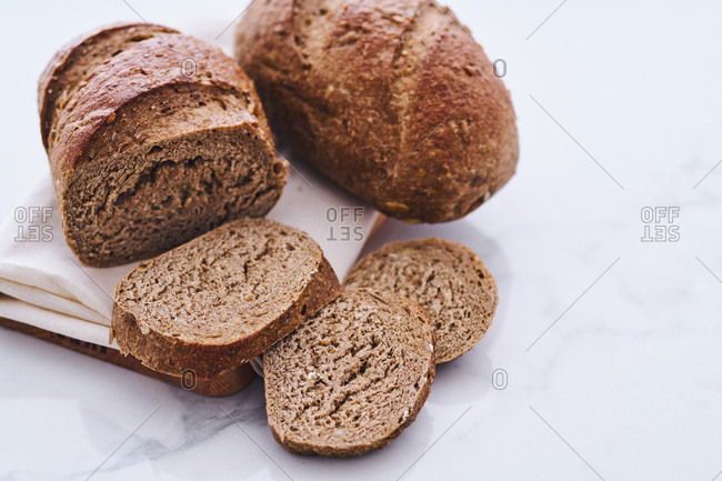 Two loaves of rye bread sliced