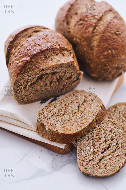Close up of two loaves of rye bread sliced