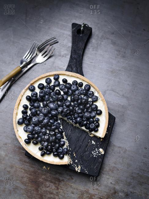 Blueberry tart missing one slice