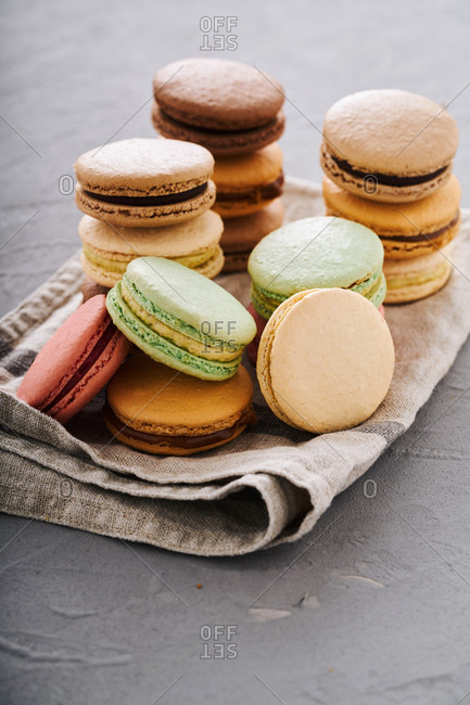 Macarons stacked on a towel