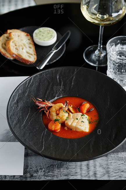Rich soup with mussels, shrimps and fish