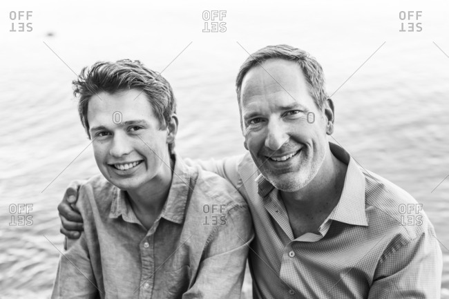 Monochrome father-son portrait on the lake