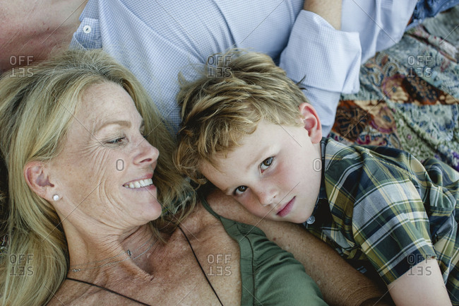 Top view of mom smiling at youngest son cuddling during family portrait