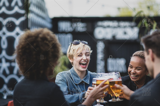 Friends drinking in an outdoor bar in summer