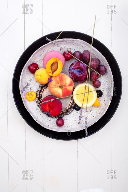 Composition with food and berries on white background inspired by abstract painting