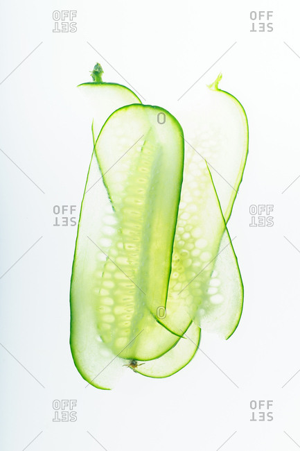 Minimalistic composition with thin cucumber slices