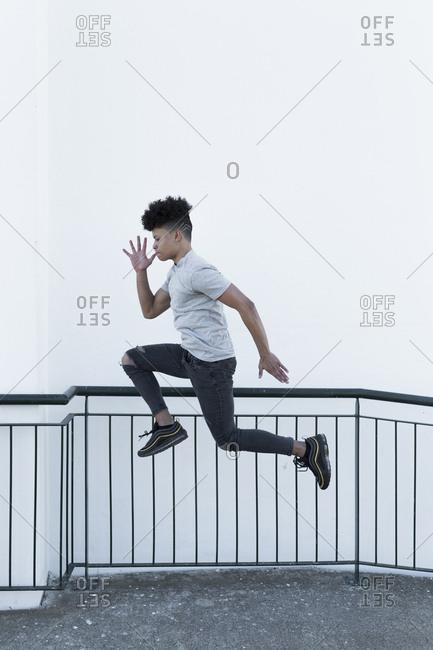 Portrait of stylish Latin male jumping
