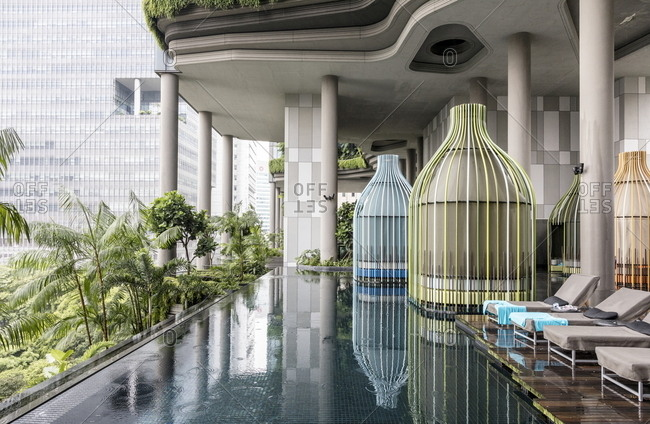 Singapore - October 21, 2017: Detail of luxury swimming pool at Parkroyal Hotel