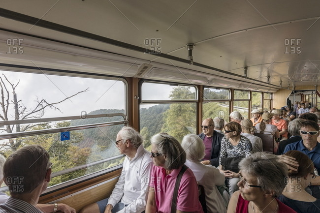 Ticino, Switzerland - July 14, 2017: Many people sitting inside railroad car in the mountains