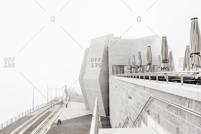 Ticino, Switzerland - July 14, 2017: Detail of the Fiore di Pietra building on the summit of Monte Generoso on a foggy day