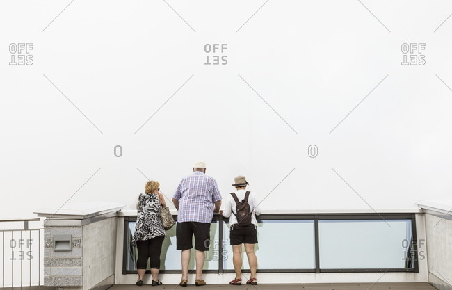 Ticino, Switzerland - July 14, 2017: Tourists looking at the view from the Fiore di Pietra building on the summit of Monte Generoso