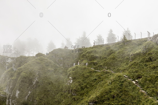 Tourists hiking on Monte Generoso, Ticino, Switzerland