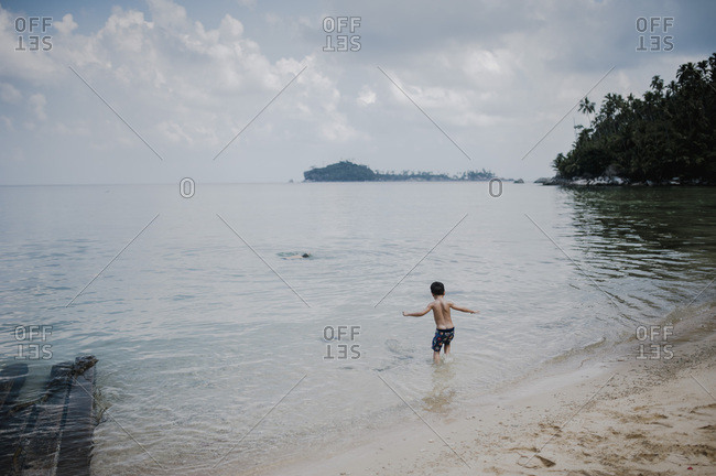 Boy swimming at a beach in Malaysia