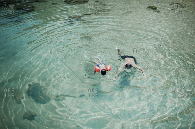 Father and son swimming off the coast of Malaysia