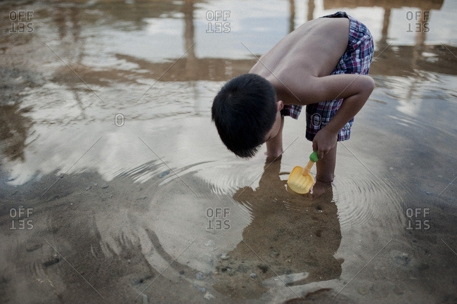 Little boy playing in the water on the coast of Malaysia