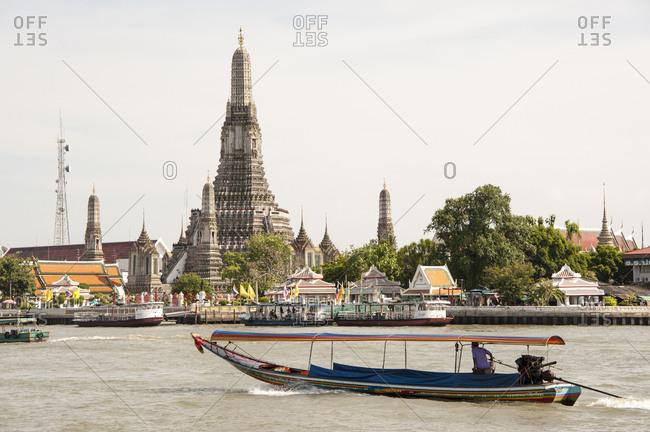Bangkok, Thailand - May 19, 2012: Wat Arun Temple along the banks of the Chao Phraya River