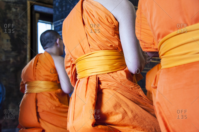 Back view of Buddhist monks meditating