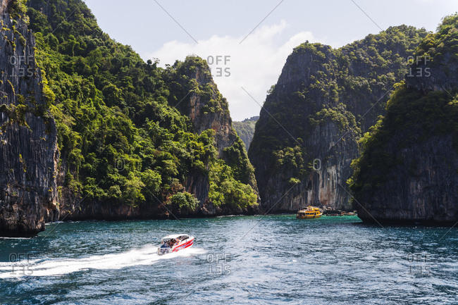 Tourist boats on the water in the Phi Phi Islands in Thailand