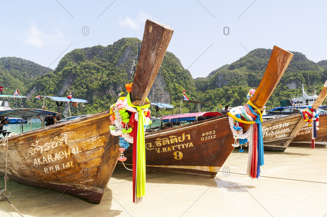 Phi Phi Islands, Thailand - June 15, 2012: Traditional boats on the beach