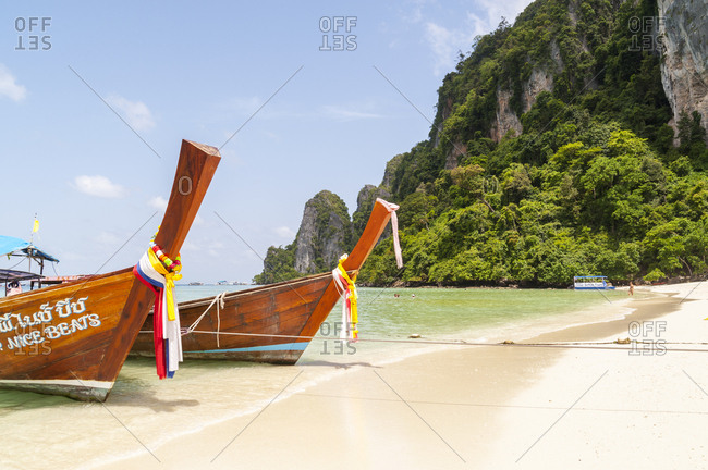 Phi Phi Islands, Thailand - June 15, 2012: Traditional boats on sandy beach