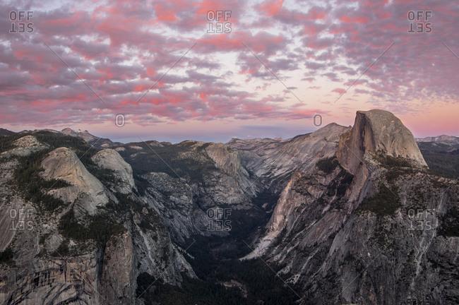 Idyllic view of mountain ranges against dramatic sky during sunrise at Yosemite National Park