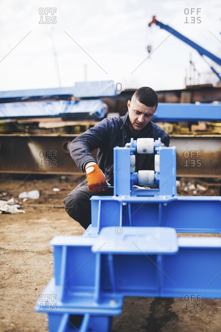 Manual worker making machinery at industry
