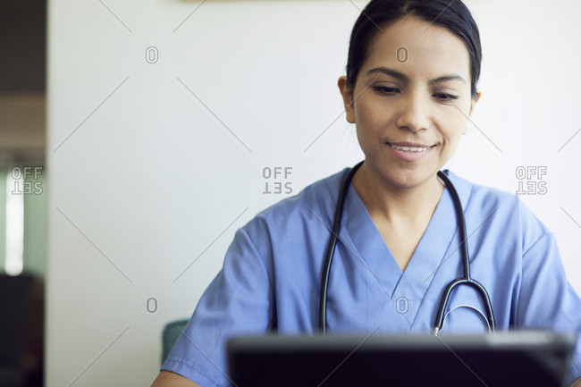 Smiling female doctor using tablet computer in hospital