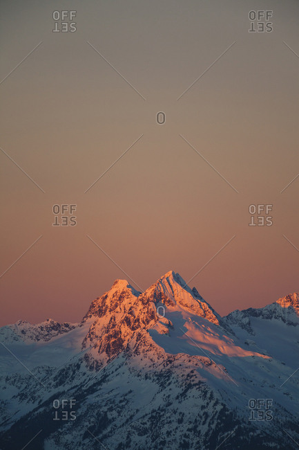 Scenic view of snowcapped mountains against clear sky during sunrise at Garibaldi Park