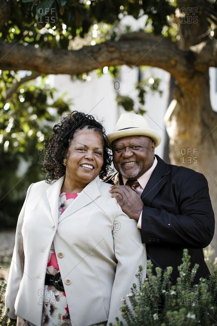 Portrait of happy senior couple standing at park