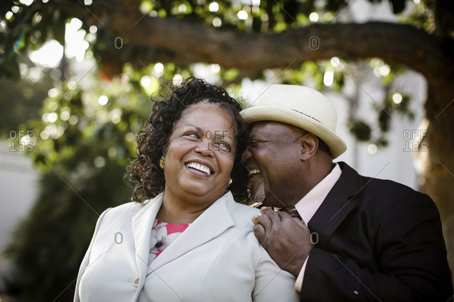 Close-up of happy senior couple standing at park