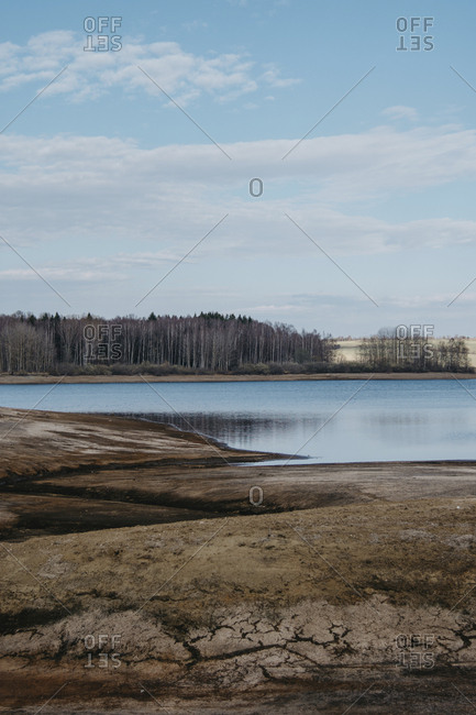 Scenic view of calm Lake Vlasina against sky in forest