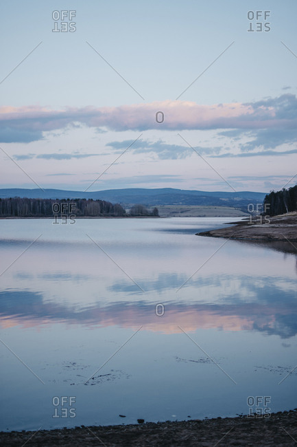 Scenic view of calm Lake Vlasina against sky during sunset