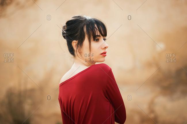 Alluring model in red dress