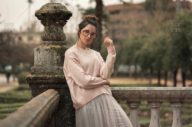 Pensive woman on terrace of castle