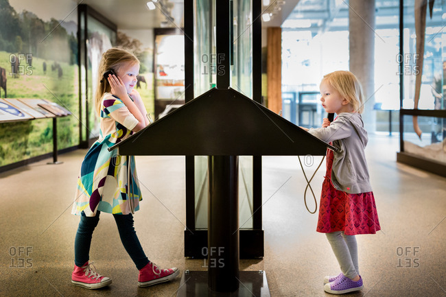 Two girls looking at museum exhibit