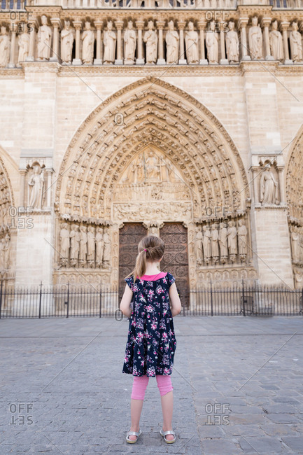 Girl looking at the Notre-Dame Cathedral in Paris