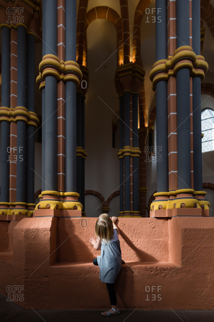 Girl looking up at columns in a building in Luxembourg