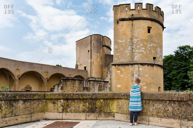 Girl visiting Porte des Allemands in Metz, France