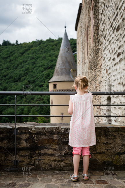 Rear view of girl exploring fortress in Luxembourg
