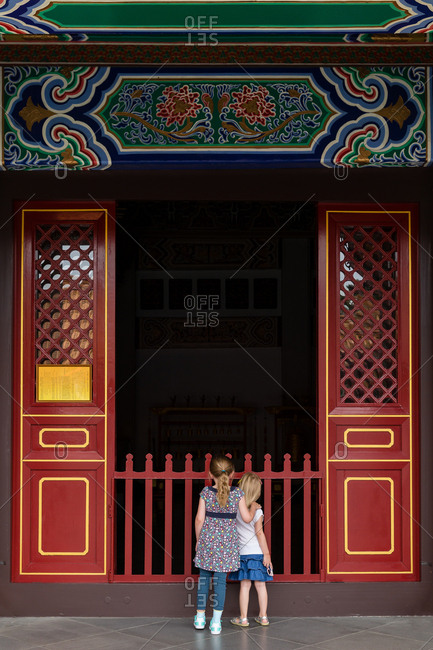 Two girls looking into opening of a Taiwanese building