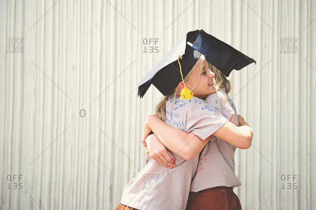 Sisters hugging on graduation day