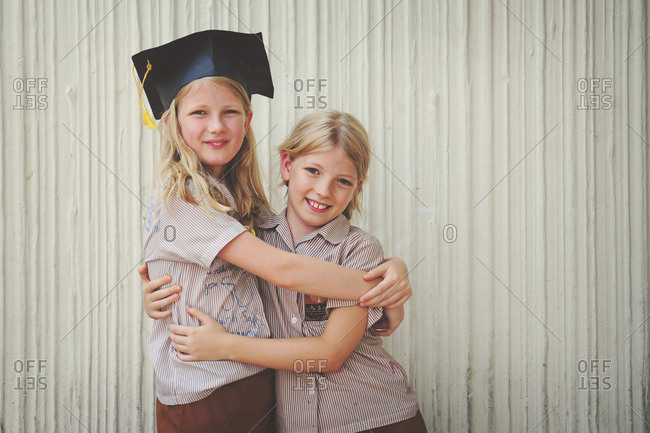 Two sisters hugging on graduation day