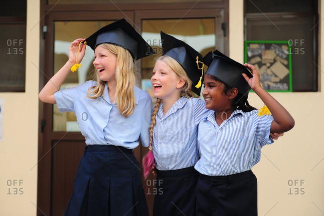 Three girls smiling on graduation day