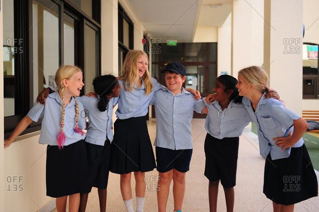Group of kids wearing school uniforms