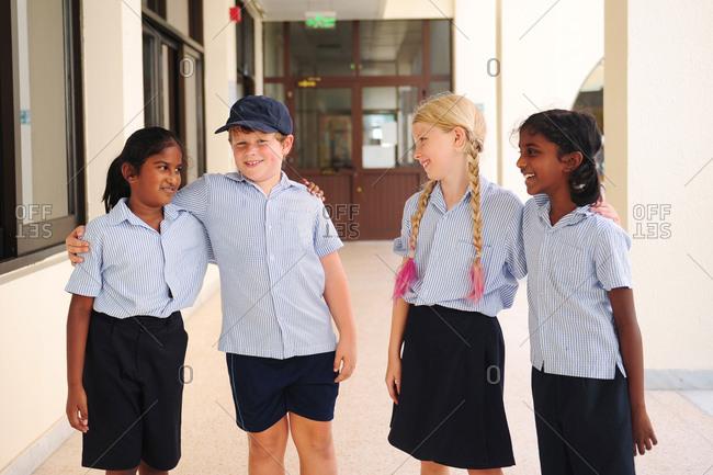 Group of children wearing school uniforms