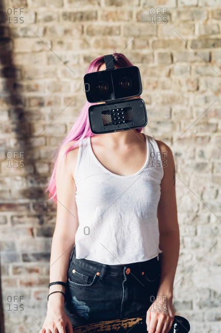 Young woman with pink hair wearing 3d viewer